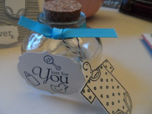 Recycled glass favor jar with Just for You tag and Onsie